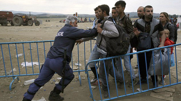 Police pushing refugees back